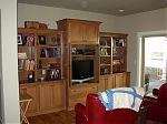 Stained Alder Entertainment Center with Arched Flat Panel Doors